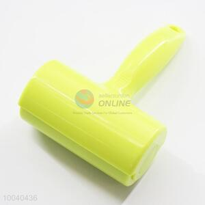 Green mini lint roller/dust remover
